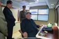 신형 대구경조종방사포 시험사격에 미소짓는 김정은 위원장