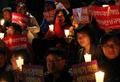 '국정원 규탄, 촛불 들고'