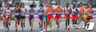 여자 마라톤 '42.195km 긴 여정'