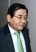 굳은 얼굴로 회의실 향하는 김대환 노사정 위원장