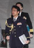 굳은 표정의 나가시마 토루 주한 일본 무관