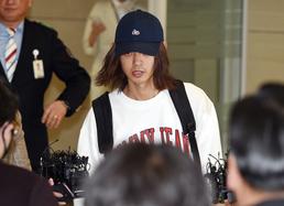 '성관계 불법 촬영·유포 혐의' 정준영 입국