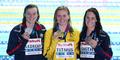 티트머스, 미국 선수 사이에서 금메달 들고