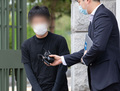 취재진 질문에 답변하는 '웰컴투비디오' 손정우