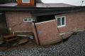 폭우로 망가져버린 주택